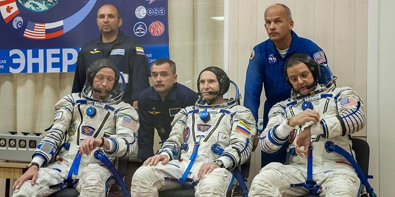 The crew of Soyuz TMA-7 on the day of lift-off